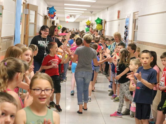 The underclassmen at R.C. Waters Elementary School, which are in first and second grade, offered high fives to their outgoing third grade classmates.
