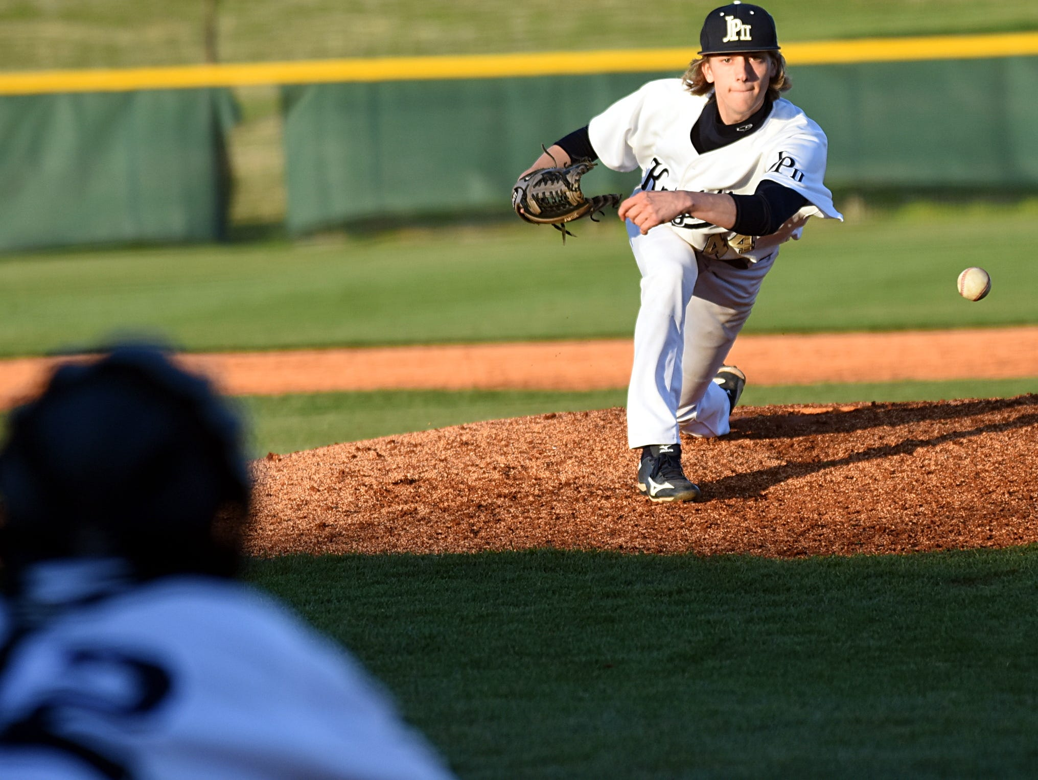 Pope John Paul II High junior Nate Pianto delivers a fifth-inning pitch. Pianto pitched three innings of hitless relief in Tuesday evening's 8-2 win over visiting Madison (Ohio) High.