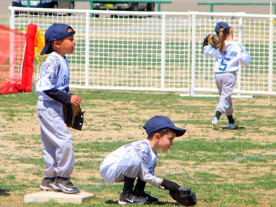 A grounder takes a little patience for this young tee-ball player.