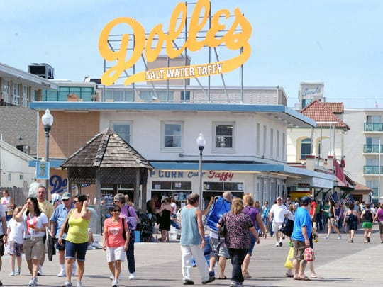 Visitors to Rehoboth Beach cruise the boardwalk near