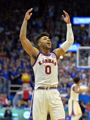 Kansas Jayhawks guard Frank Mason III (0) motions to the crowd in overtime against the West Virginia Mountaineers at Allen Fieldhouse. Kansas won 84-80.