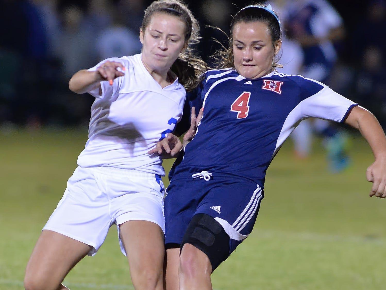 White House High freshman midfielder Leanna Nesbitt battles for possession with White House Heritage sophomore Callie Jo Roach.
