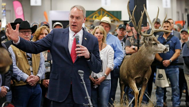 Interior Secretary Ryan Zinke speaks during an conservation announcement at the Western Conservation and Hunting Expo Friday in Salt Lake City.