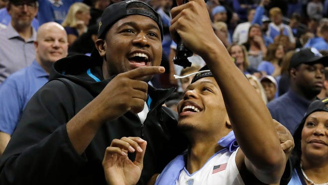 North Carolina's Nate Britt, right, and Villanova's Kris Jenkins celebrate after after the Tar Heels advance to the Final Four.