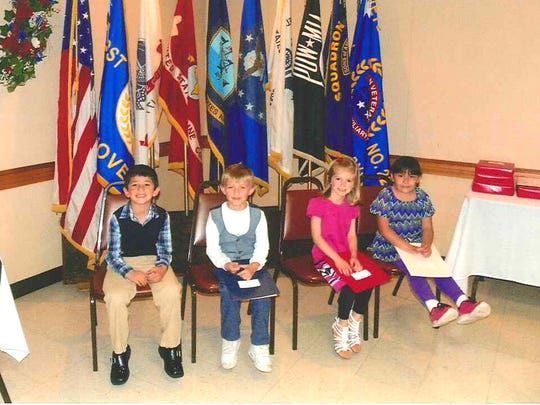 American Flag Coloring Contest Winners in Kindergarten and first grade, from left, are: Rocco DiFatta, Ethan Laughter and Baileigh Stetter, all of St. Joseph Elementary, and Abigail Livingston of Park Hills Elementary. Missing from the photo were: Karly Gerow and Jacob Eusini of St. Joseph Elementary.