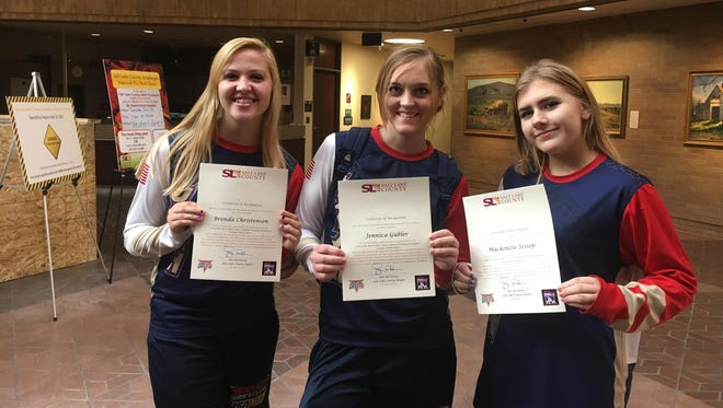 Brenda Christensen (left), Jennica Gubler (center) and Mackenzie Jessop (right) pose for a picture after being recognized by the Salt Lake City Council for their achievements in wrestling.