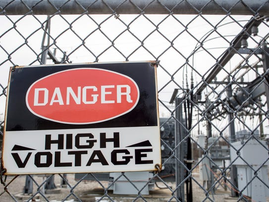 A danger sign is seen posted in front of the DTE substation