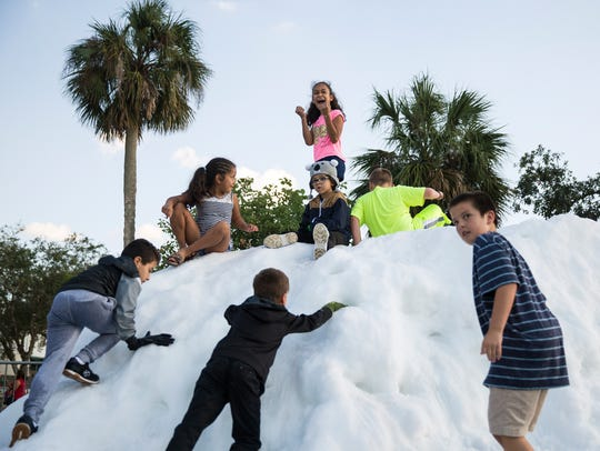 Tall mounds of snow were made for kids to climb on