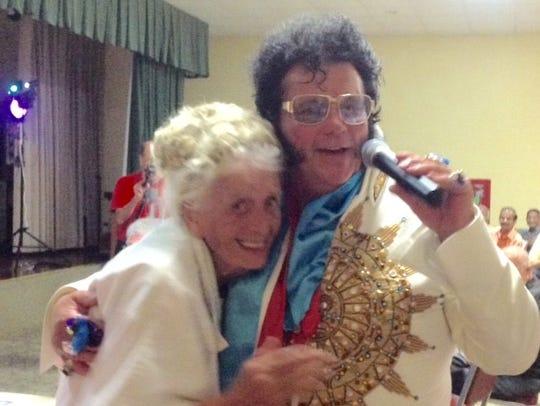 Elvis impersonator Mike Hollandwith Gerda Smethers.
