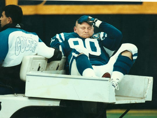 (INDIANAPOLIS STAR FILE PHOTO) Indianapolis Colts player Steve Emtman grimmaces as he is taken off the field in the second quarter after suffering a season-ending knee injury, his second in as many years. The Colts lost to Dallas 27-3. Oct. 10, 1993 PHOTO BY RICH MILLER.