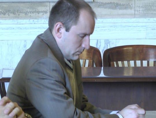 Former Dutchess County Legislator Michael Kelsey listens