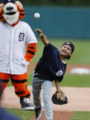 J.D. Schilp throws out the first pitch before Wednesday's