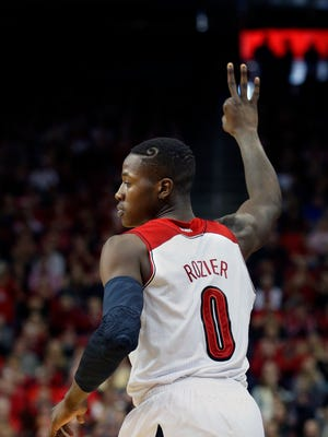 Louisville's Terry Rozier signals the crowd after a made 3-pointer last season.