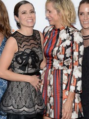 """Actors Linda Cardellini (left) and Kristen Wiig arrive at the """"Welcome to Me"""" premiere during the Toronto International Film Festival on Sept. 5."""