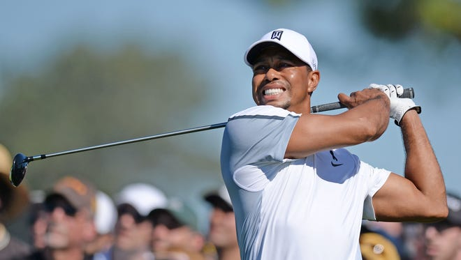 Tiger Woods hits his drive on the 12th during the first round of the Farmers Insurance Open golf tournament at Torrey Pines Municipal Golf Course - South Co.