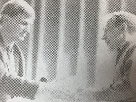 Farm Bureau member Bill Holbrook presented American Red Cross director Art Hayden with a check for $6,835.87 in April 1997.