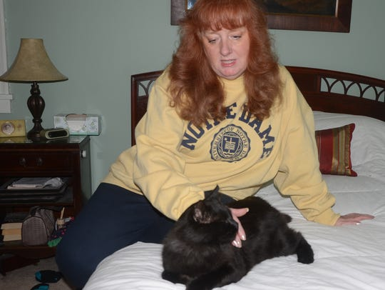 Laurie Sullivan with the stray cat recovering from