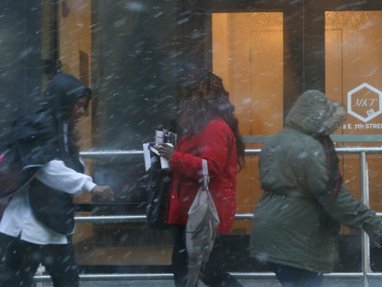 People struggle with the elements on W. 7th Street