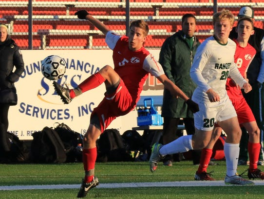 Attempting a balancing act is Canton senior midfielder