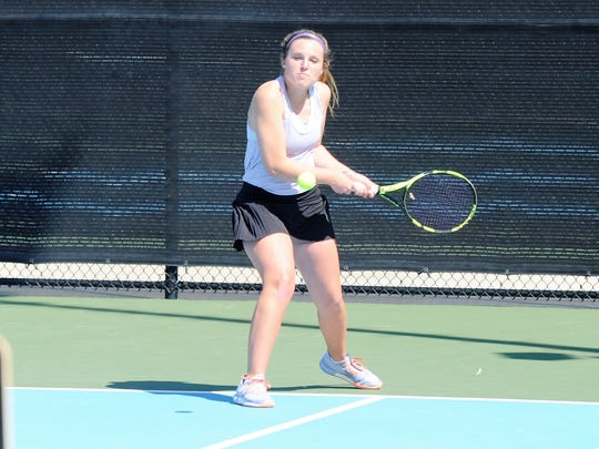 Wylie's Andrea McMillan lines up a backhand shot during