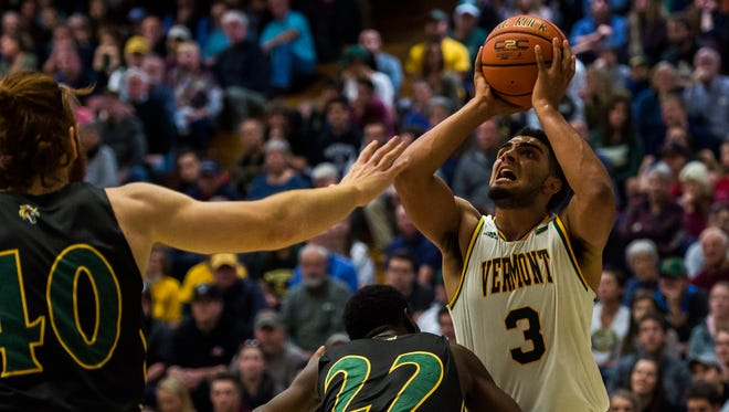 UVM's Anthony Lamb takes the shot for three points during the first half of their men's basketball match up at Patrick Gym against the University of Main Fort Kent Wednesday night, Nov. 22, 2017.