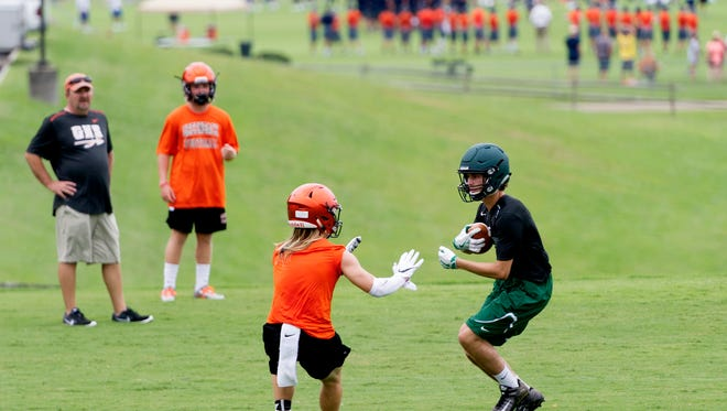 Greenback (orange) and Webb (green) play at the East Tennessee 7 on 7 Perimeter Passing Day at Maryville College in Maryville, Tennessee on Saturday, July 15, 2017. Thirty-four schools have committed to the event, which matches teams up into pools and allows each to practice their passing game for the upcoming season.