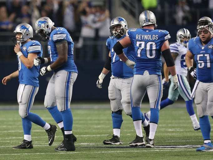 The Detroit Lions leave the field after a Matthew Stafford