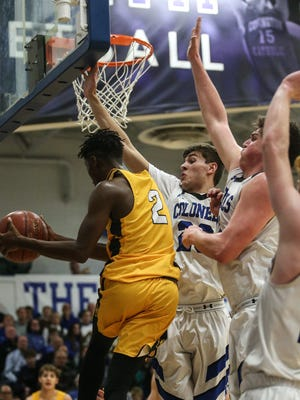 Covington Catholic defenders work to keep Moeller's Isaiah Payton away from the basket during their game at CovCath, Tuesday, December 12, 2017.
