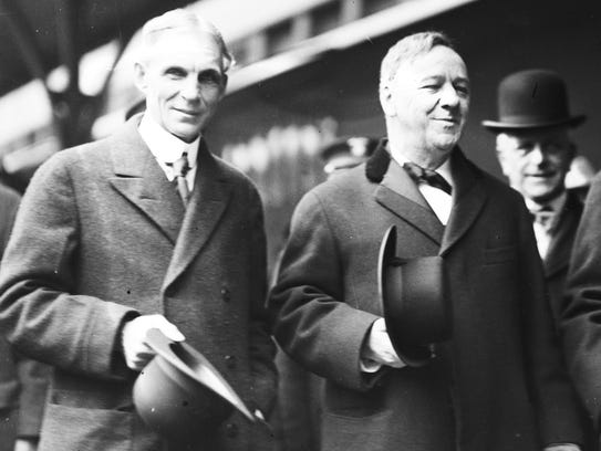 Henry Ford, left, is photographed at the Michigan Central