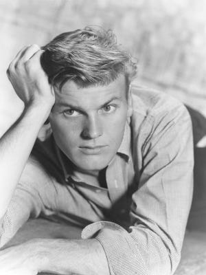 "Tab Hunter, the '50s heartthrob who starred in ""Damn Yankees"" and ""Battle Cry,"" came out as gay in his 2005 memoir."
