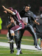 From 2014: Park Ridge quarterback Evan Matthews celebrates