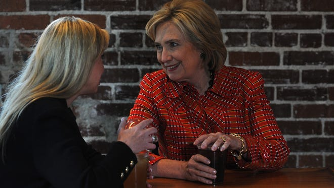 Democratic candidate for president Hillary Clinton, right, speaks with Reno Mayor Hillary Schieve at Coffeebar during a campaign visit to Reno on Monday, Nov. 23, 2015