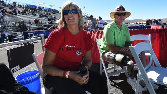 Linda Elvin, left, and her husband Brian watch as a plane goes by during the Reno National Championship Air Races at Stead Airport on Sept. 17, 2015.