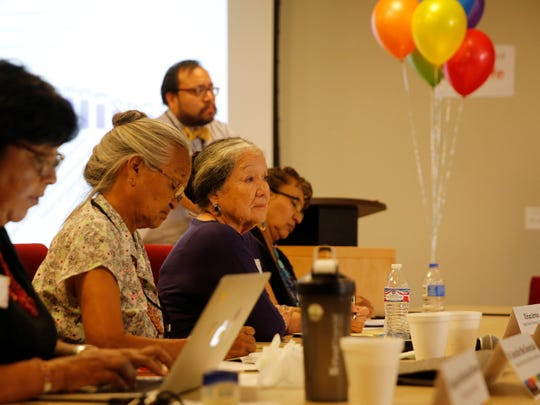Navajo Nation Women's Commission member Vivian Arviso, third from left, listens to testimony during the LGBTQ Community Listening Session at the Diné Pride symposium on Friday at the Navajo Division of Transportation in Tsé Bonito.