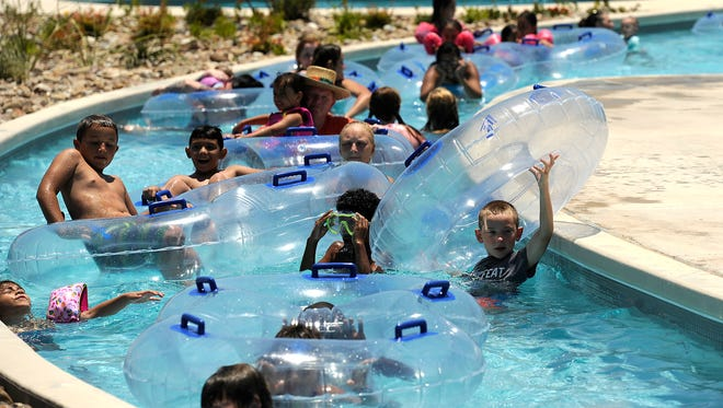 Kids float around the lazy river on Thursday, June 22, 2017, at Adventure Cove.
