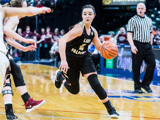 Winchester's Maddie Lawrence, shown here in the 2018 Class 2A state championship game, scored 20 points to help the Golden Falcons beat Triton Central on Saturday to advance to the regional championship.