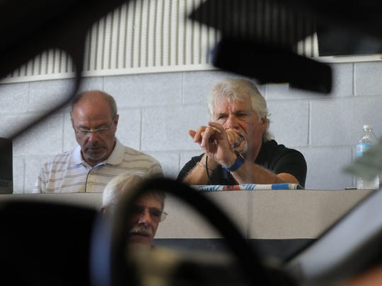Auctioneer Jerry Caldwell takes bids on the auction floor at the Manheim Detroit in Carleton on Thursday, June 28, 2018.