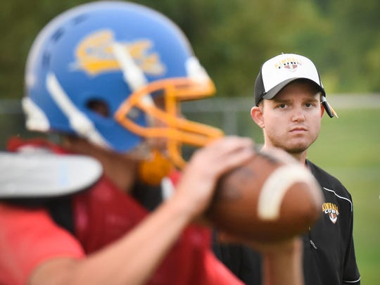 Kimball's new head coach Johnny Benson watches practice Friday, Aug. 18, in Kimball.