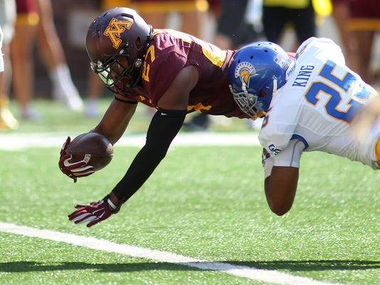 Minnesota running back David Cobb (27) scores a touchdown against San Jose State safety Akeem King (25) in the first quarter during an NCAA college football game on Saturday, Sept. 20, 2014, in Minneapolis. (AP Photo/Andy Clayton-King)