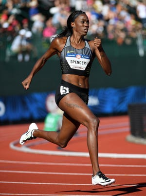 FILE -- Ashley Spencer competes at the U.S. Olympic trials. The former Lawrence North High School athlete finished second in the 400 hurdles  to earn a spot on the Rio team.