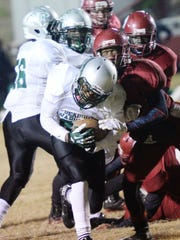 Peabody's Bruce Price (front) runs with the ball during the first round of the 2014 Class 4A playoffs against Minden.