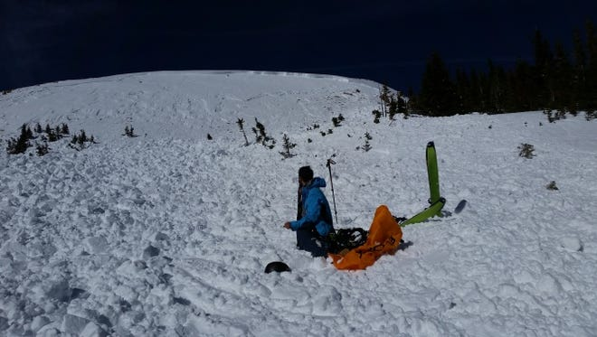 A search and rescue member works the avalanche debris field where a climber was killed northwest of Idaho Springs.