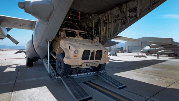 An Oshkosh Corp. JLTV leaves an air transport cargo
