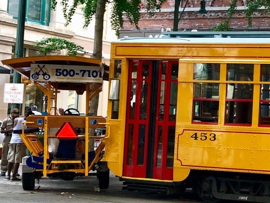 Trolley, party bike collide