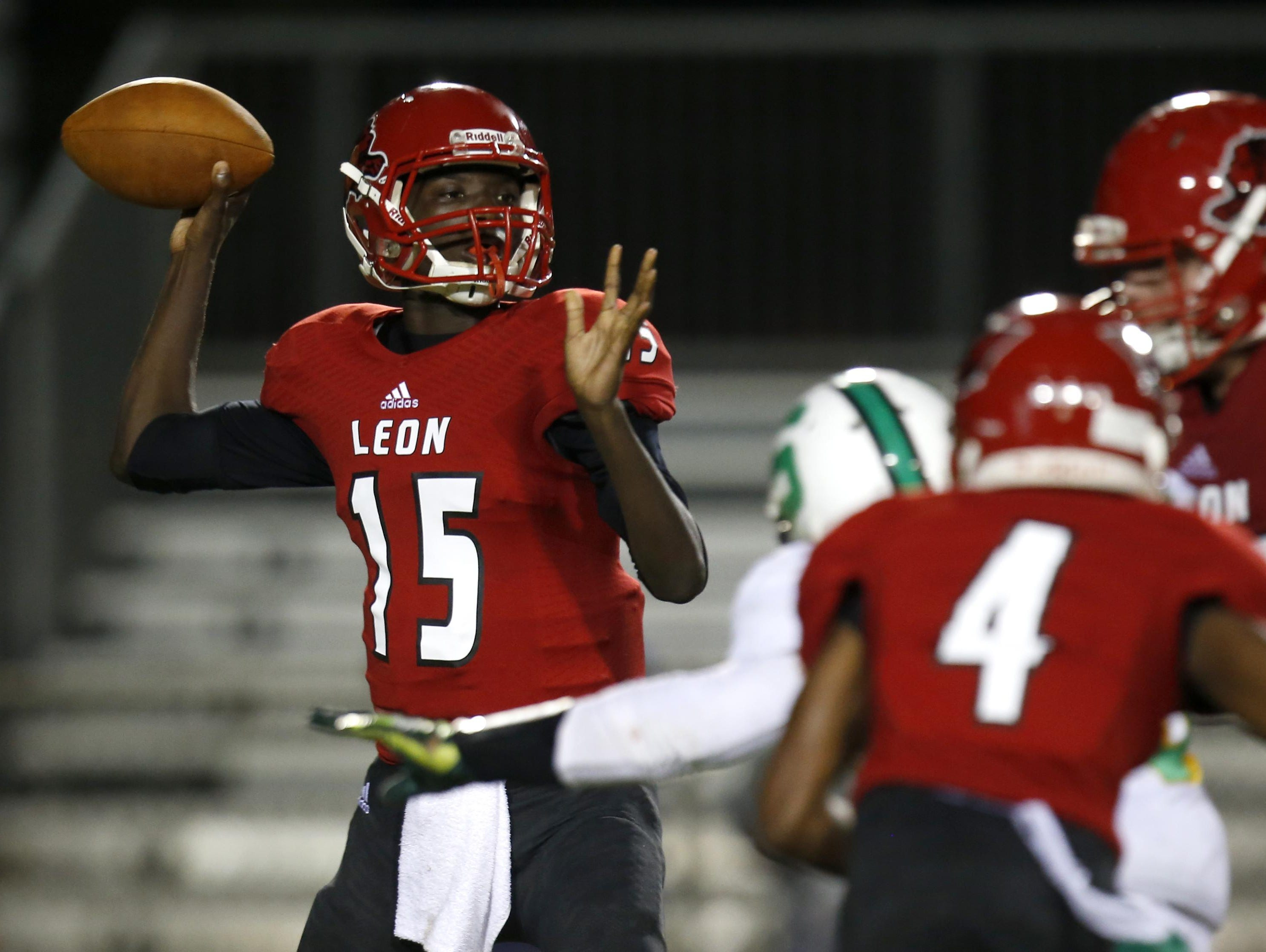 Leon quarterback Ty Glasco makes a throw against Suwannee as the Lions kicked off their 100th season Friday at Gene Cox Stadium with a 10-7 win over the Bulldogs on a last-second field goal.