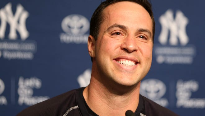 New York Yankees baseball player Mark Teixeira talks to reporters at a press conference before a game against the Cleveland Indians at Yankee Stadium in New York, Friday, Aug. 5, 2016. Teixeira announced his plans to retire at the end of the season.