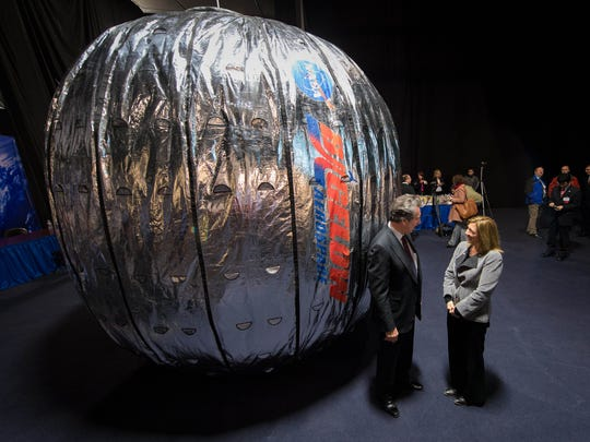 In this Wednesday, Jan. 16, 2013 photo made available by NASA, NASA Deputy Administrator Lori Garver and Robert T. Bigelow, president and founder of Bigelow Aerospace, stand next to the Bigelow Expandable Activity Module (BEAM) during a news conference in Las Vegas. It's a technology demonstration meant to pave the way for moon bases and Mars expeditions, as well as orbiting outposts catering to scientists and tourists. (Bill Ingalls/NASA via AP)