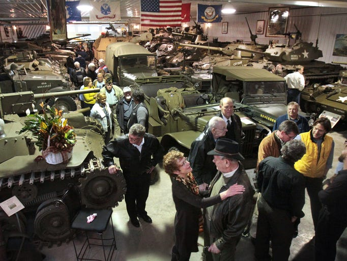 The calling for Fred Ropkey, Jr., 84, Crawfordsville, operator of the Ropkey Armor Museum, was held on Thursday, Nov. 14, 2013 in the Crawfordsville museum he filled with military vehicles and other military history items he collected since the age of 15. Friends paid their respects to Ropkey's widow, Lani, and shared stories of the colorful Marine Corps veteran as they lingered amidst his extensive collection of vehicles displayed in the museum, which he moved from Indianapolis to Crawfordsville nearly a decade ago. A celebration in honor of Ropkey, who died Thursday, Nov. 7, will be held at Crown Hill Funeral Home Saturday at 1 p.m.