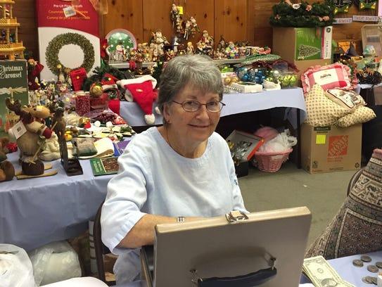 Georgia Davis prepares cash to facilitate shoppers