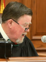 Judge C. Creed McGinley speaks during a status hearing